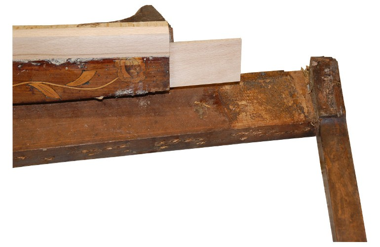 The side rail was consolidated and new beechwood added to replace the woodworm damaged timber